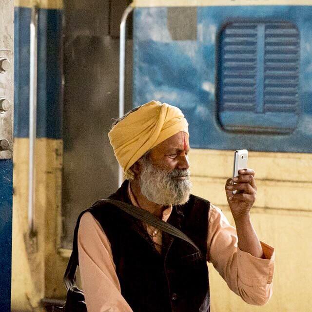 We all love our mobile phones. Agra train station. April 2015 #India #agra #incredibleindia #mobilephone #nikon_photography_