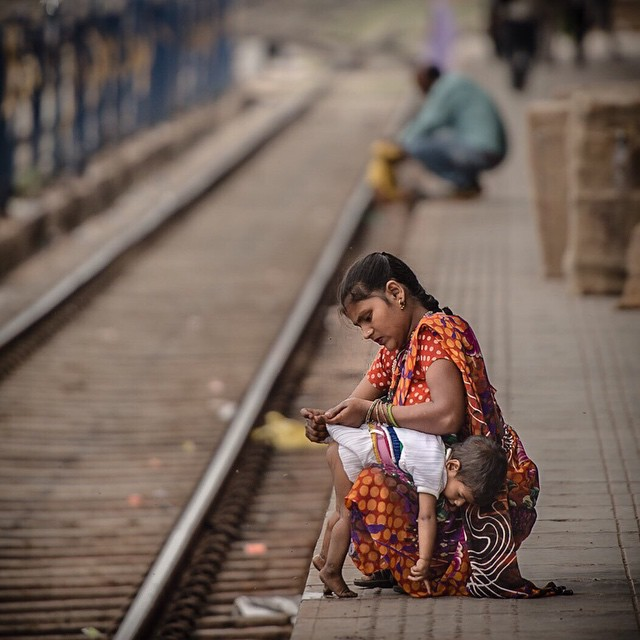 Diaper change on the fly. Thought this was a good photo for Mother's Day cause moms do a lot every day! Agra train station. India April 2015