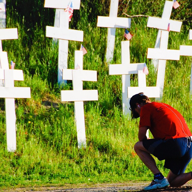Remembering those who gave their lives to protect us and others in the world. There is a hillside in California filled with crosses. I happened to see this runner stop for a minute to offer a prayer.