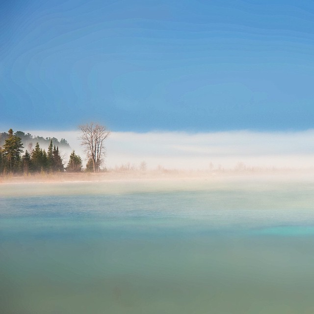 View from my office. Nice layer of fog. And yes Lake Michigan is really that color when the conditions are right. Charlevoix Michigan 2012.