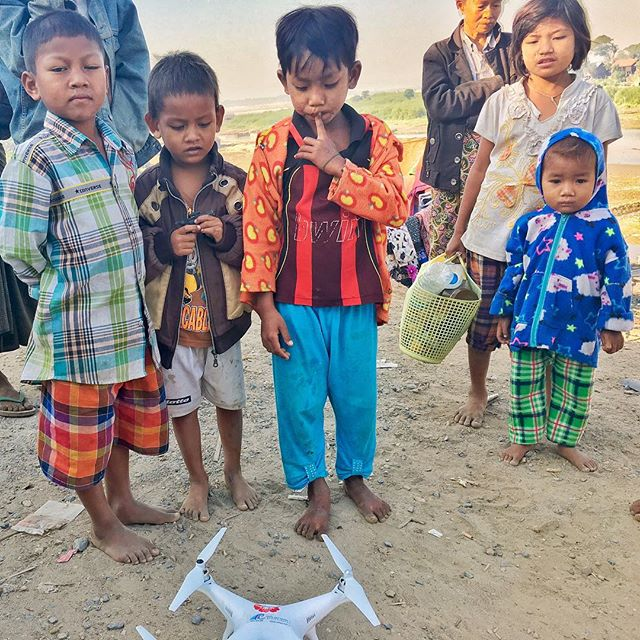 It might be from outer space. The drone in Myanmar. The little boy in orange started to hyperventilate when he got to hold the drone.
