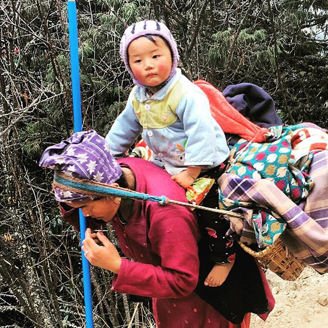 Hitching a ride. Humbling to see what people can carry in Nepal.