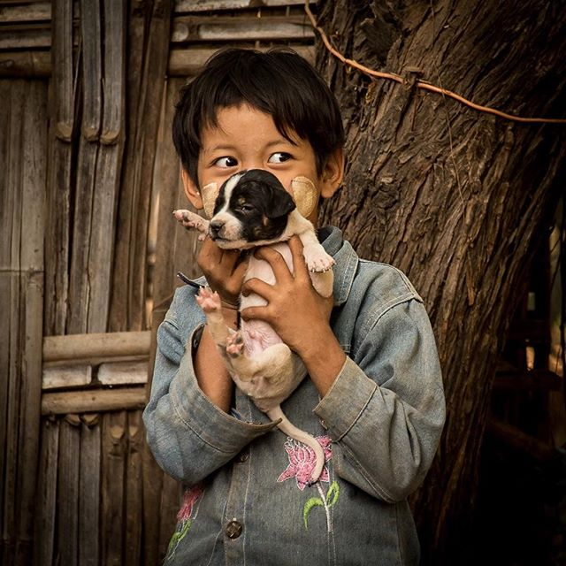 Puppy eyes. I mean what's not to like about a little kid holding her puppy? Bagan Myanmar 2016.