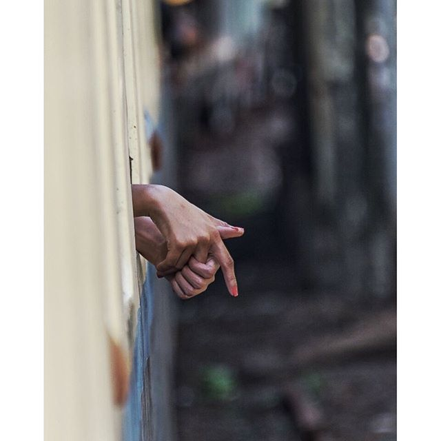 Hands. Looked out the train in Myanmar and saw some hands.